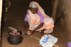 poor woman cooking meat