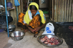 poor woman make food of meat