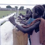 poor children filling their Bottles from a clean water point