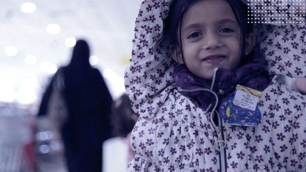 a girl wearing warm cloths from humanitarian assistance