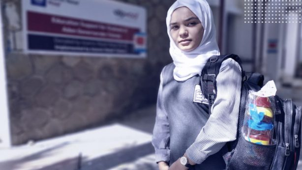 an orphan girl geting education, wearing hijab and school uniforms