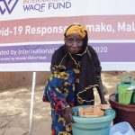 an old woman got WASH kits to help prevent diseases