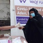 a woman receives a food assistance